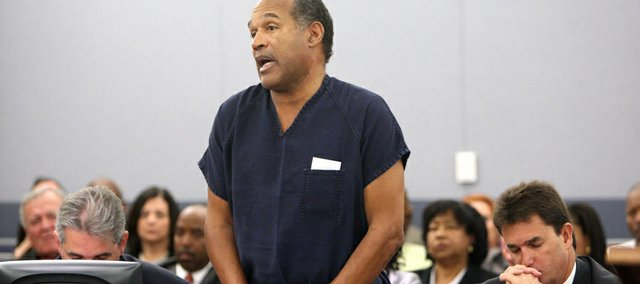 O.J. Simpson speaks during his sentencing hearing Friday at the Clark County Regional Justice Center in Las Vegas. Sitting right to Simpson is his lawyer Yale Galanter.