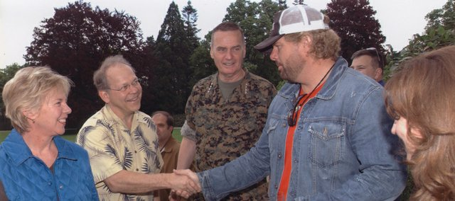Carol Hatton, far left, and her husband, Dr. Don Hatton, of Lawrence, meet country singer Toby Keith while visiting Carol's cousin, Marine Gen. James Jones, when Jones was NATO commander stationed in Belgium. Keith was putting on a performance that day.