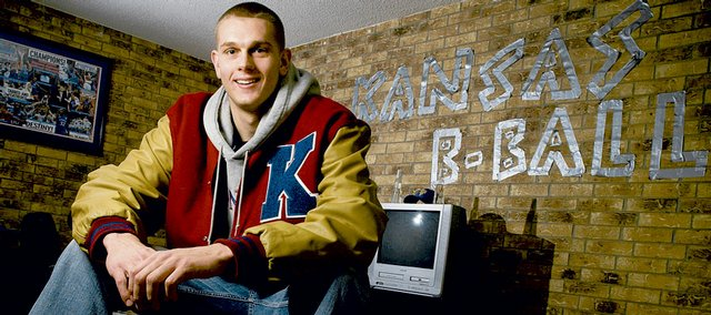 """Kansas center Cole Aldrich, pictured here on Wednesday, has discovered one of the many useful purposes for duct tape. As a statement of his love for Kansas basketball, Aldrich used duct tape to spell out the words """"Kansas B-Ball"""" on the living room wall of his apartment in the Jayhawker Towers that he shares with teammate Tyrel Reed."""