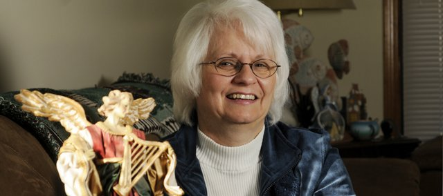 "Vicki Julian is a Lawrence resident who recently wrote ""Christmas: A Season for Angels,"" a collection of short stories dealing with fictional people who had angels intervene in their lives."