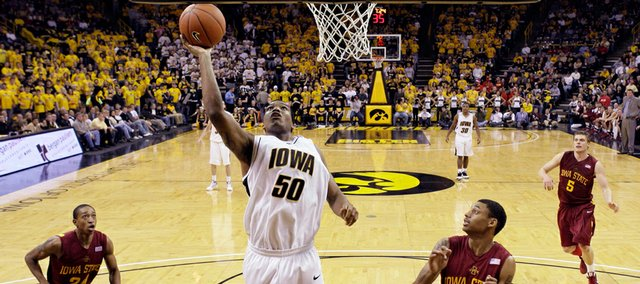 Iowa's Jarryd Cole (50) shoots between Iowa State defenders Cameron Lee, left, Diante Garrett (10) and Lucca Staiger (5) during the second half of this NCAA college basketball game, Friday, Dec. 12 2008, in Iowa City, Iowa. Iowa won 73-57.