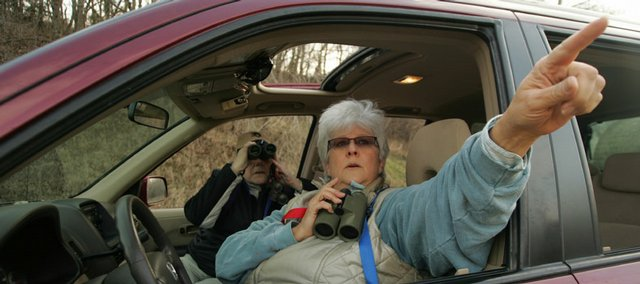 Nancy Leo, left, peers through her binoculars as Helen Hewins describes a nest she saw Sunday morning at Perry State Park. Hewins and Leo, president of the Kansas Ornithological Society, were two of many birders to participate in the annual Christmas Bird Count sponsored by the National Audubon Society.