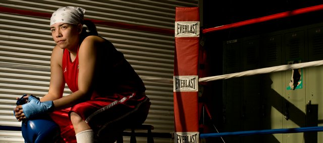 "Boxer Mioshia ""Yosh"" Wagoner, pictured Friday in the gym where she and the Haskell Boxing Club train, recently returned from Ningbo City, China, where she received the silver medal while competing in the AIBA Women's World Boxing Championships."
