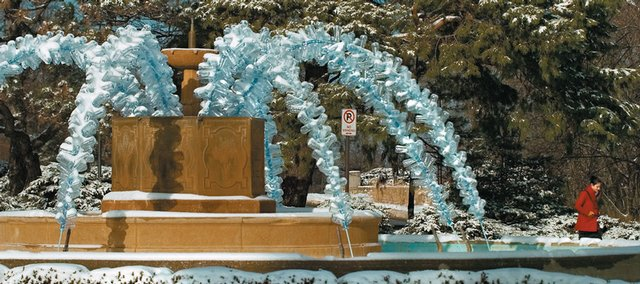 The Chi Omega memorial fountain features plastic water bottles collected in less than a week by the staff at KU Recycling. The piece is by Matthew Farley, a senior in sculpture at The University of Kansas. The public art sculpture, Frozen Assets, will remain on display through January 2009.