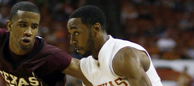 Texas guard A.J. Abrams, right, dribbles against the defense of Texas State guard Brent Benson, left, during the first half of an NCAA  college men's basketball game Saturday, Dec. 13, 2008, in Austin, Texas. Abrams' game-high 30 points helped the Longhorns to an 81-73 victory.