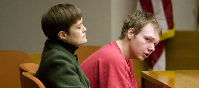 Defendant Kellam Jones turns to listen as Heather Hein reads a prepared speech about her son Roland Klundt in Judge Michael Malone's Division IV courtroom on Friday. Jones, who pleaded guilty to second-degree murder in the shooting death of Baker University student Roland Klundt, 20, on June 7, was sentenced to fourteen years and two months.