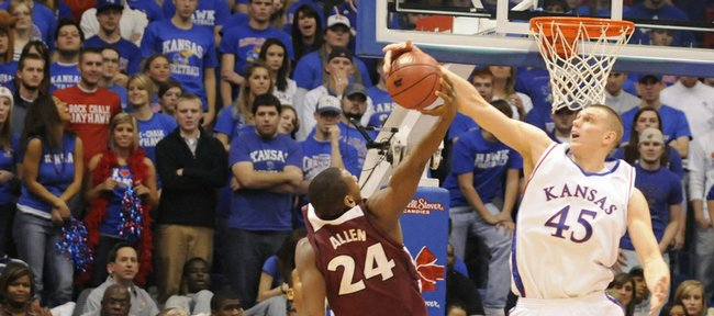 Kansas center Cole Aldrich gets the upper hand on a rebound over Temple forward Lavoy Allen during the second half Saturday at Allen Fieldhouse.