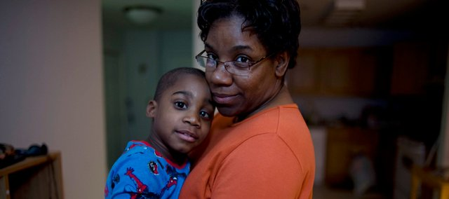 Cassandra Edmonds, with her 4-year-old son, Quinn, enrolled in Medicaid after she lost her job with the Bridgeport, Conn., school district. Around the country, enrollment in Medicaid is soaring because of the stagnant economy, and states are asking for billions of dollars in relief from the federal government.