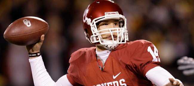 In this Dec. 6 file photo, Oklahoma quarterback Sam Bradford drops back to pass during the first quarter of the Big 12 championship football game against Missouri in Kansas City, Mo. Bradford was voted the Associated Press college football player of the year on Monday.