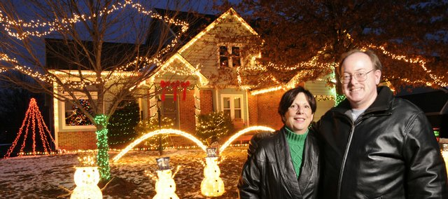 Mary Ann and Gary Martin have a lot of cars stopping outside their house at 1132 Parkside Circle. Not only do passersby get to view a colorful light display but they also get to listen to music synchronized to the display, broadcast to your car's FM radio. The Martins were photographed Monday, outside their home.