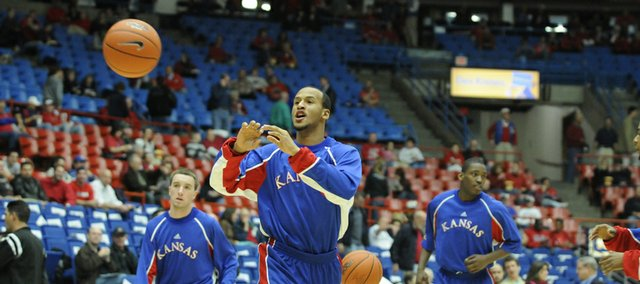 Kansas guard Travis Releford catches a pass during warmups before taking on Arizona Tuesday, Dec. 23, 2008 at the McKale Center in Tucson.