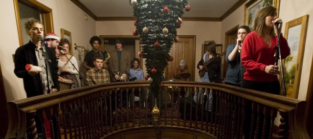 A band entertains holiday guests Sunday night at the home of Serina Hearn and Tony Backus.