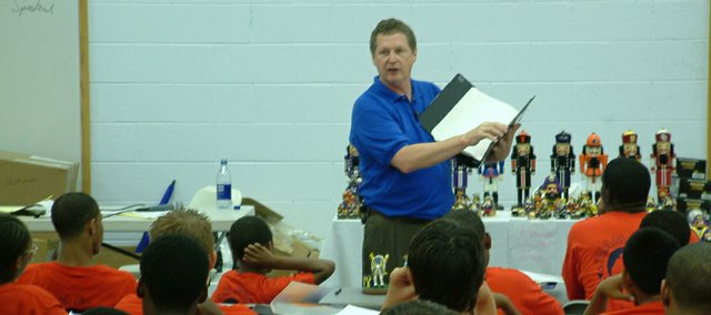 Former Kansas university football coach Mike Gottfried speaks at a camp for boys who don't have fathers in their lives. Gottfried founded Team Focus, a program aimed at providing guidance to kids growing up without fathers, in 2000.