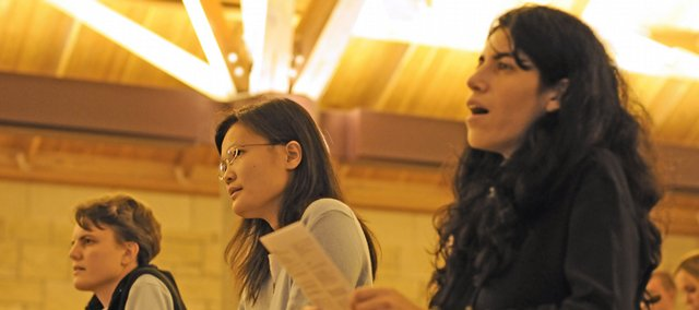 Sisters Elena Morcelli, Debbie Li and Loredana Mazzei pray on a November evening at the St. Lawrence Catholic Center.