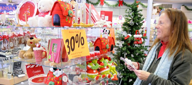 Connie Woydziak, Lawrence,  stocks up for next year with some reduce priced holiday items at Rod's Hallmark Shop, 2329 Iowa St. Friday, Dec. 26, 2008. Shoppers were back at stores Friday looking for further discounts and big sales on remaining holiday stock.