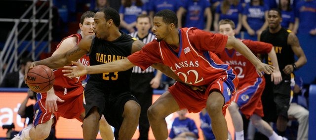 KU's Marcus Morris (22) and Tyrel Reed hound Albany's Tim Ambrose during the second half at Allen Fieldhouse on Tuesday, Dec. 30, 2008.