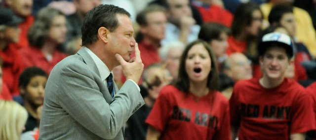 Kansas head coach Bill Self is heckled by Arizona fans during the second half Tuesday, Dec. 23, 2008 at the McKale Center in Tucson.