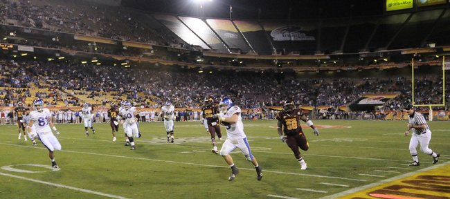 Kansas quarterback Todd Reesing takes off on a long run past the Minnesota defense during the fourth quarter of the Insight Bowl Wednesday, Dec. 31, 2008 at Sun Devil Stadium in Tempe, Arizona. The play set up a final Jayhawk touchdown for running back Jake Sharp.