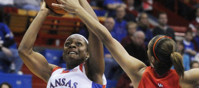 KU's Danielle McCray shoots over Houston's Courtney Taylor in the first half of Kansas' 73-56 victory over the Cougars on Wednesday Dec. 31 at Allen Fieldhouse.