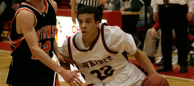 Lawrence High's Dorian Green, right, gets a step on Shawnee Mission Northwest's Ryan Arel in this Dec. 19, 2008, file photo at Lawrence High. Green has been nearly impossible to guard this season, averaging 27 points a game for the 4-2 Lions.