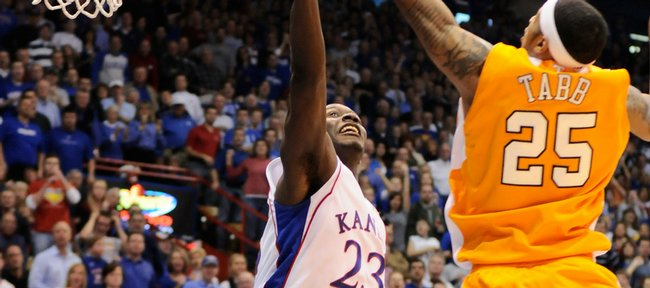 Kansas forward Mario Little goes for a rebound with Tennessee guard Josh Tabb during the first half Saturday, Jan. 3, 2009 at Allen Fieldhouse.