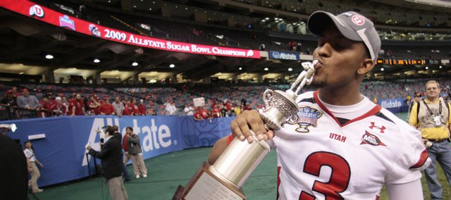 Utah quarterback Brian Johnson kisses his Sugar Bowl MVP trophy after his NCAA football game in the Sugar Bowl in New Orleans on Saturday. Utah defeated Alabama 31-17.