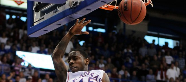 Kansas guard Tyshawn Taylor delivers an exclamation point in front of Tennessee forward Scotty Hopson during the second half Saturday, Jan. 3, 2009 at Allen Fieldhouse.