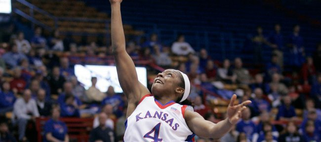Kansas guard Danielle McCray puts in a layup and draws a foul during a first-half drive to the basket in Sunday's game against New Mexico State at Allen Fieldhouse, Jan. 4, 2009.