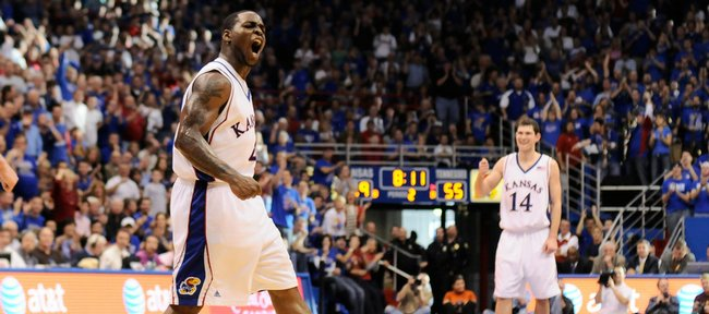 Kansas guard Sherron Collins pumps up the crowd after a dunk by teammate Cole Aldrich during the second half against Tennessee. Collins led the Jayhawks with 26 points on Saturday at Allen Fieldhouse. Tyrel Reed, who scored eight points, takes in the moment.