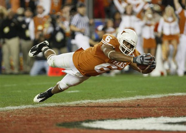 Texas' Quan Cosby dives into the end zone for the winning touchdown against Ohio State in the Fiesta Bowl on Monday in Glendale, Ariz. Texas won, 24-21.