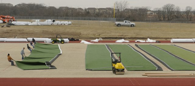Crews started laying down rolls of new artificial turf at Free State High School on Jan. 6. It takes a six-man crew three weeks to put the field together.