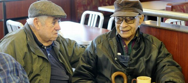 Lincoln Johnson, Lawrence, right, a World War II veteran, brought a dog back from Germany by hiding it in his duffel bag. Johnson visits with his friend Corky Reed on Monday at the McDonald's restaurant, 1309 W. 6th, where a group of friends meet daily. The dog was a mixed breed dog named Waldmann, later shortened to Wally.