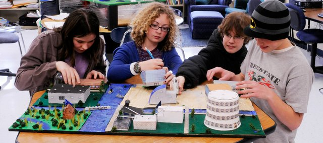 West Junior High School eighth-graders are putting their design skills to the test as they prepare entries for the National Engineers' Week Future City Competition. Front from left are Caitlin Erickson, Lexi Adams, John McCain and Kolbe Murray, and, rear from left, Antonio Schoneich and Tucker Prescher. They worked Wednesday at the school.