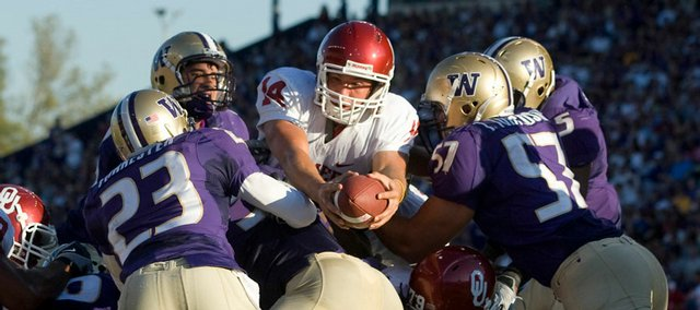Oklahoma quarterback Sam Bradford reaches over the Washington defense to score a touchdown in this September 13, 2008 file photo. Oklahoma will play Florida for the BCS championship at 7 p.m. Thursday night.