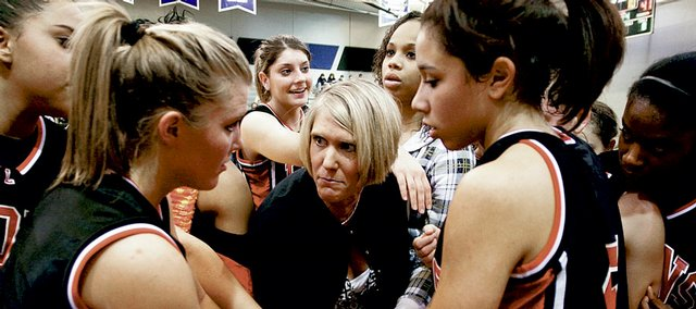 Lawrence High girls' basketball coach Kristin Mallory talks to her team during a breaking in LHS' 48-43 win over Olathe Northwest on Friday, Jan. 9, 2009.