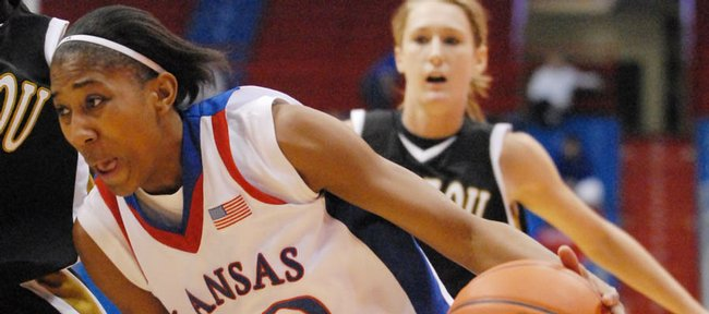 KU's Sade Morris drives the lane in the first half against Missouri on Wednesday night at Allen Fieldhouse. Morris tied a career-high with 20 points, and KU came away with a 75-58 victory.