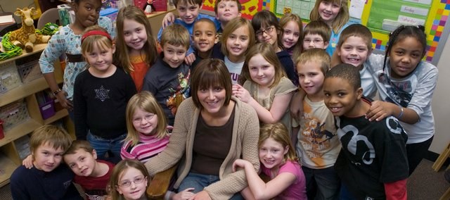 Amanda Vail, a second-grade teacher at Prairie Park School, is one of 32 teachers in Kansas to receive a Horizon Award, which honors educators who have completed their first year of teaching. She gathered with her students Wednesday at the school, 2711 Kensington Road.