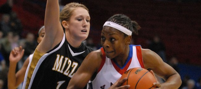 Danielle McCray goes up against Missouri's Bekah Mills in the first half of Wednesday's game.