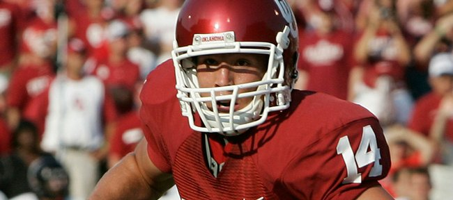 Sam Bradford carries against Cincinnati in this September 2008 file photo in Norman, Okla. The Oklahoma quarterback and Heisman Trophy winner announced he would return to the Sooners for his junior season in a news conference on Wednesday.