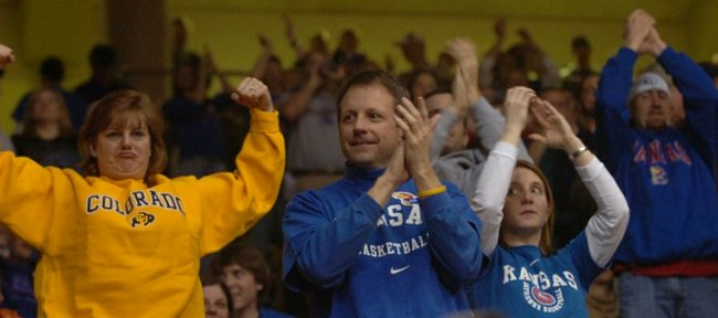 Despite their losing effort, Colorado fan Ski Warford, Englewood, Colorado, throws up her guns alongside Kansas fans John Sinovic, Overland Park, and Shannon Scrivner, Denver, during the second half of a game against the Buffaloes at the Coors Events Center in Boulder in 2007.