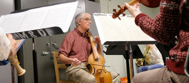 "As a visual device, ""framing"" enables a photographer to work with his or her scene and makes use of elements within the scene to construct creative images. In this file photo, Kansas University professor Paul Laird leads members of the Collegium Musicum during a rehearsal."