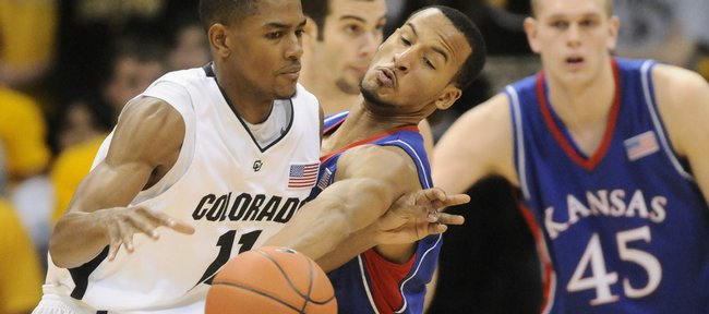 Kansas guard Travis Releford pokes the ball loose from Colorado guard Cory Higgins during the first half Saturday, Jan. 17, 2009 at the Coors Events Center in Boulder, Colorado.