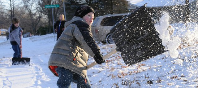 Guthrie Bricker, 5 foreground and his brother Jackson Maher, 9, background at left, shovel off a sidewalk at 2535 Belle Haven St. Friday, Jan. 16, 2009. The boys mother Dacia McCabe Maher is the head of a program at Douglas County Senior Services that provides volunteers to shovel sidewalks for the elderly. There aren't enough volunteers to cover everyone requesting the help so Maher's sons pitched in Friday.