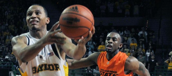 Baylor guard Curtis Jerrells, left, drives past Oklahoma State's James Anderson, right, in overtime on Saturday, Jan. 17, 2009, in Waco, Texas. Jerrells had a game high 31 points to help defeat Oklahoma State 98-92 in overtime.