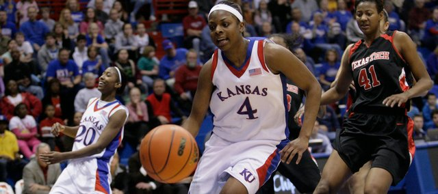Kansas' Sade Morris (20) reacts after Danielle McCray (4) can't handle a pass from Morris and the ball bounces out of bounds during the first half of the game Saturday, Jan. 17, 2009, at Allen Fieldhouse.