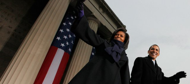 President-elect Barack Obama and his wife, Michelle, take the stage at War Memorial Plaza as they rally the crowd at a stop on their inaugural whistle stop train trip in Baltimore, Md., Saturday, Jan. 17, 2009.