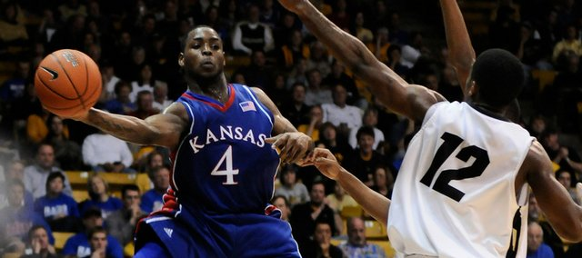 Kansas guard Sherron Collins whips a pass along the baseline around Colorado guard Dwight Thorne II during the second half Saturday, Jan. 17, 2009 at the Coors Events Center in Boulder, Colorado.