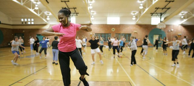 Thalia Tooke leads a Zumba class Sunday afternoon at the Community Building. The class, which offers an aerobic workout to Latin-flavored dance music, will be offered again on Feb. 22, as well as once in March and once in April at the same location.