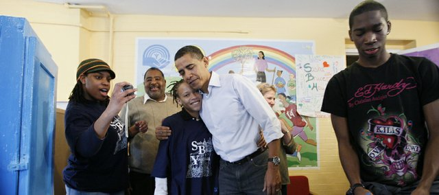 President elect Barack Obama stops for a visit while participating in a renovation project at Sasha Bruce Youthwork, a shelter for homeless or runaway teens, in Washington.
