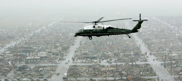 The Marine One helicopter, carrying President Bush, flies over tornado damage in Greensburg, Kan., Wednesday, May 9, 2007.